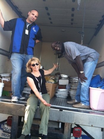 Volunteer Patti Stack assisted in the food donation pick up with RGM's  Matt Sutton and Luther Diggs. Truck was soon to have the entire floor covered with stacked donations.